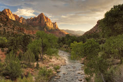 Zion. View of the Watchman in Zion National Park, Utah The Virgin River flows in to the distance leading the eye to the distant mountain range. The Setting sun royalty free stock photos