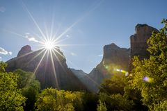 ZION CANYON NATIONAL PARK SUNSET SUN FLAIR SKIES Stock Images