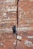 ZION NATIONAL PARK, UTAH/USA - NOVEMBER 4 : Man climbing sheer r. Ock face in Zion National Park Utah on November 4, 2009. Unidentified man Royalty Free Stock Photography