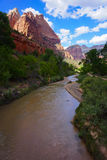 Virgin River Zion National Park. Massive mountains in rust-red stone tower above the Virgin River that winds through the Zion National Park. The rivers origin Royalty Free Stock Photography
