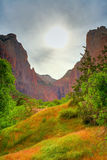 Zion sunset. Sun is shining through clouds as it set over Zion National Park in Utah Royalty Free Stock Images