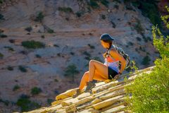 Free ZION, UTAH, USA - JUNE 12, 2018: Outdoor Beautiful View Of Young Woman With Beautiful Scenery In Zion National Park Stock Photography - 124218512