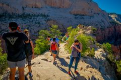 ZION, UTAH, USA - JUNE 14, 2018: Outdoor beautiful view of young hikers looking at view in Zion National park. People royalty free stock images
