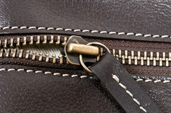 Zip. Close up to zip on leather material Stock Photos