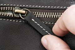 Zip. Close up to zip on leather material Stock Photo