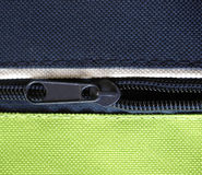 Zip. Per or  fastener joining two edges of fabric royalty free stock image
