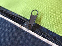 Zip. Per or  fastener joining two edges of fabric royalty free stock photo