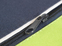 Zip. Per or  fastener joining two edges of fabric royalty free stock photography