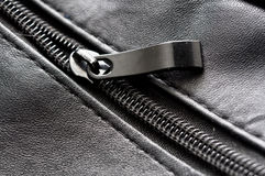Zip on black leather Royalty Free Stock Photography