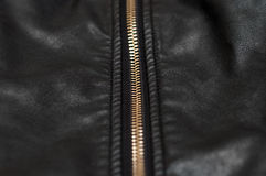 Zip on black leather material. Close up of zip on black leather material Royalty Free Stock Photography