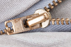 Zip on bright jeans. Macro Royalty Free Stock Image