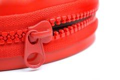 Zip. Closeup big red plasitc zip Stock Image