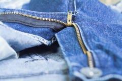 Zip front denim jeans. Blue denim jeans, open zip front background Stock Photo