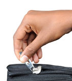 Zip with hand. Detail zip with hand on a bag with clipping path Stock Photos