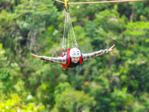 Zip-line. Men enjoying zip-line flying over the forest royalty free stock photos