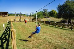Zip Line. Blue Ridge, Virginia USA – September 30th: Young boy enjoying the Zip Line at the annual Fall Festival at Layman Family Farm located in Blue Ridge stock images