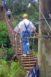 A Zip Line Bridge on Maui in the Hawaiian Islands. A zip-line (or zip line, zip wire, aerial runway, aerial ropeslide, death slide, flying fox, or foefie slide ( Royalty Free Stock Photos