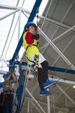 Zip line and climbing training indoors. Children enjoying a Zip line and climbing training indoors with safety equipment Royalty Free Stock Photography
