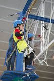 Zip line and climbing training indoors. Children enjoying a Zip line and climbing training indoors with safety equipment Stock Photo
