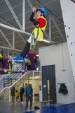 Zip line and climbing training indoors. Children enjoying a Zip line and climbing training indoors with safety equipment royalty free stock image