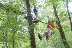 Zip line experience in forest. Zip line experience in the forest Royalty Free Stock Photography