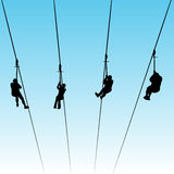 Zip Line Race. An image of people in a zip line race Royalty Free Stock Photos