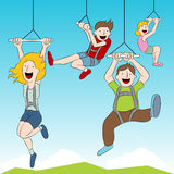 Zip Line Riders. An image of people riding a zip line Royalty Free Stock Image