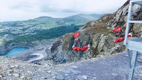 Zip line in Wales. Europe's longest zip line over lake and valley in Wales royalty free stock photography