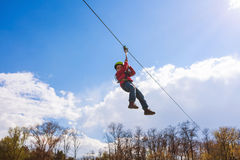 Zip line. Young boy sliding on zip line royalty free stock images