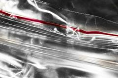 Zip package with red stripe macro. Zip package with red stripe close royalty free stock photos
