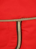 Zip on red textile background, Stock Photography