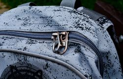 Zip on small gray black bag. Backpack for school Stock Image