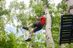 On zipline in adventure park Stock Images