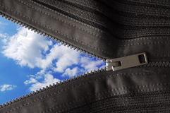 Zipped blue sky. Blue summer sky behind zip showing beginning concept Royalty Free Stock Photography