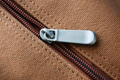 Zipper. Close-up with brown background Stock Photography
