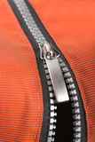 Zipper. On the orange bag stock images