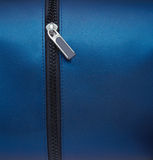 Zipper. Opening on clean blue bag Stock Images