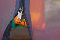 Zipper. Metallic zipper on blue fabrics Stock Images