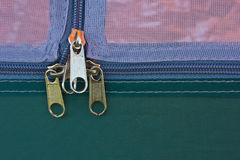 Zipper. Metallic zipper on blue fabrics Stock Image