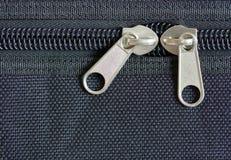 Zipper on black cloth stock image
