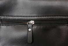 Zipper on the black leather Stock Image