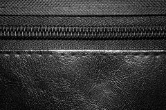 Zipper on black leather bag close up Royalty Free Stock Image
