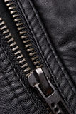 Zipper on black leather jacket Royalty Free Stock Photos