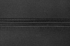 Zipper on black Royalty Free Stock Photos