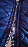 Zipper on a Blue Coat Stock Photo
