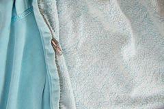 Zipper on the blue jacket Stock Photos