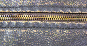 Zipper on brown leather motorcycle jacket Royalty Free Stock Images