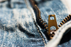 Zipper close-up on blue jeans texture Royalty Free Stock Photos