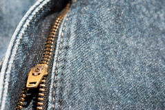 Zipper close-up on blue jeans texture Stock Photo