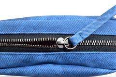 Zipper. Dark blue metal zipper on the bag Royalty Free Stock Photo